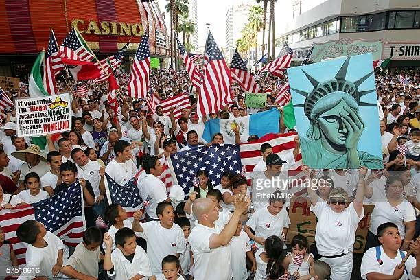 Thousands of people rally at the Fremont Street Experience in support of immigrant rights as part of Day Without Immigrants May 1 2006 in Las Vegas...