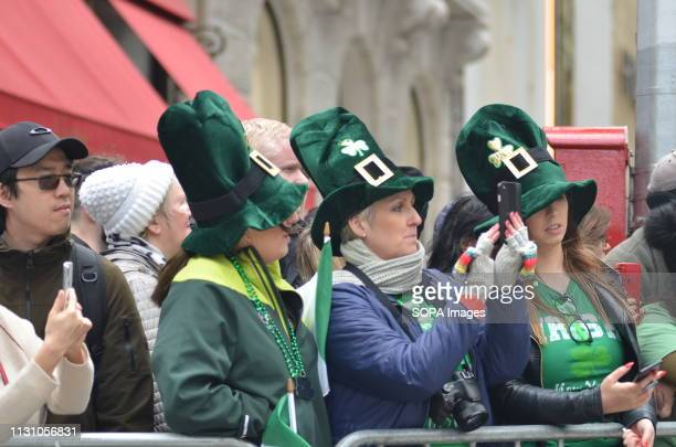 Thousands of people seen attending the annual St Patricks Day Parade on 5th Avenue in New York City