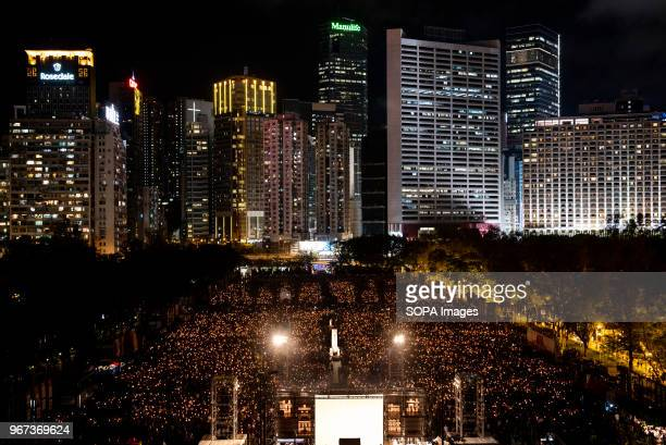 Thousands of people seen with their candles lighten up during the vigil service Hundreds of thousands of Hong Kong people attended the annual...