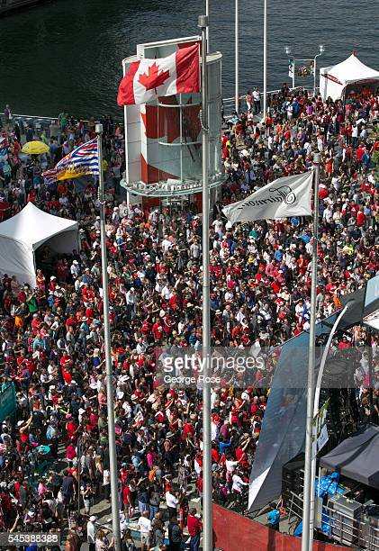 Thousands of people showing their patriotism jam into the area around Canada Place waterfront convention centre to celebrate Canada Day on July 1...