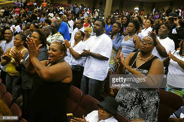 Thousands of people sing and pray at a memorial service for Bernie Mac at the The House of Hope Church on August 16, 2008 in Chicago, Illinois.