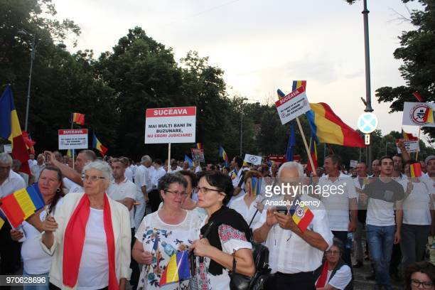 Thousands of people stage a protest organized by the PSD against abuses committed by anti-corruption prosecutors, next to the Romanian Government...