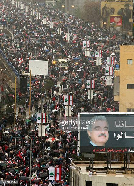 Thousands of people stream towards Martyrs Square to take part in the commemoration marking the third anniversary of the assassination of Prime...
