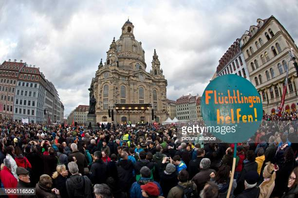 Thousands of people take part in a rally under the motto 'For Dreden for Saxony for openmindedness fellow humanity and dialogue with one another'...
