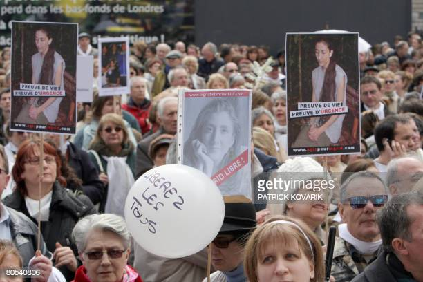 Thousands of people take part in a Solidarity marche, on April 6, 2008 in Paris, to call for the release of French Colombian hostage Ingrid...