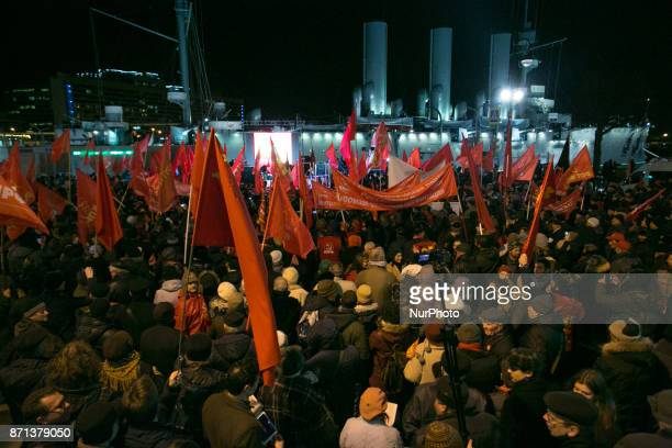 Thousands of people take part in march to mark the 100th anniversary of the 1917 Bolshevik revolution in StPetersburg Russia on November 7 2017