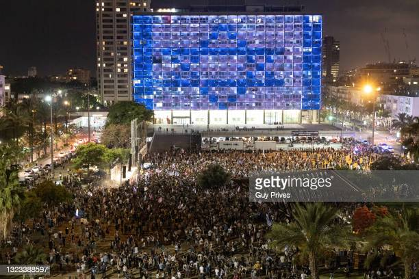 Thousands of people take part in spontaneous celebrations in Rabin Square after the confidence vote on June 13, 2021 in Tel Aviv, Israel. The new...