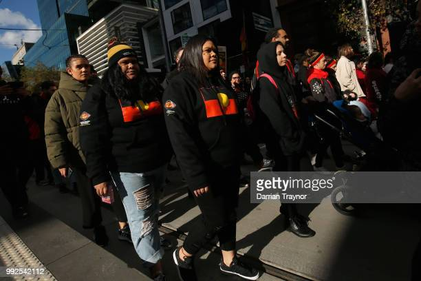 Thousands of people take part in the NAIDOC march on July 6 2018 in Melbourne Australia The march marks the start of NAIDOC Week which runs this year...