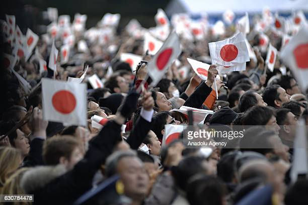 Thousands of people visit the Imperial Palace which was opened for the New Year's public appearance by the Japanese royal family in Tokyo Japan on...