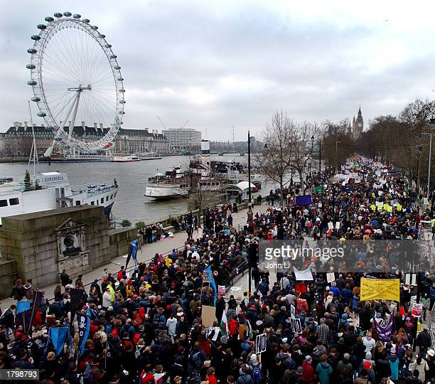 Thousands of people walk along the Embankment past the Millenium Wheel towards Hyde Park as they participate in an antiwar protest march February 15...