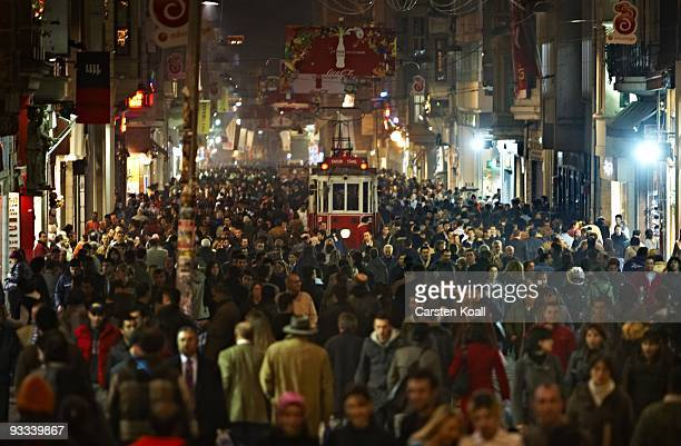 Thousands of people walk down the Istiklal Cadesi beside the traditional tram in the district Beyoglu near the Taxim Square on December 08, 2006 in...