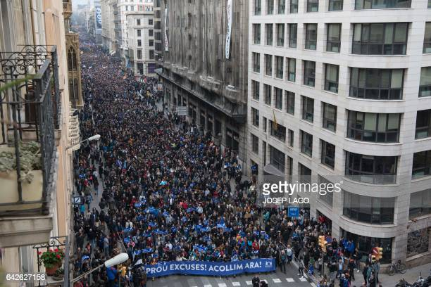 Thousands of people walk in a street of Barcelona during a demonstration demanding to welcome refugees on February 18 2017 Some 160000 people...