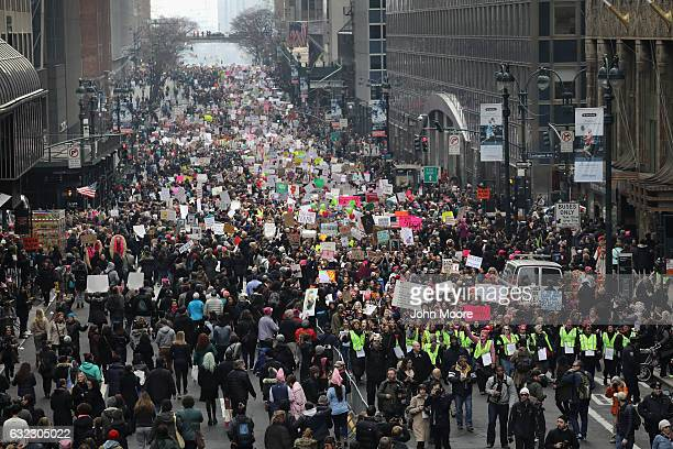 Thousands of people walk on 42nd Street while taking part in the Women's March on January 21 2017 in New York City The Midtown Manhattan event was...