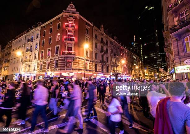 Thousands of people walking during the Bahnhofsviertelnacht in the redlight district of Frankfurt am Main Germany 17 August 2017 The...