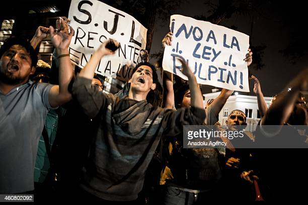 Thousands of Peruvian young people shouts slogans and hold banners as they march peacefully to demand promotion of employment for youths and the...