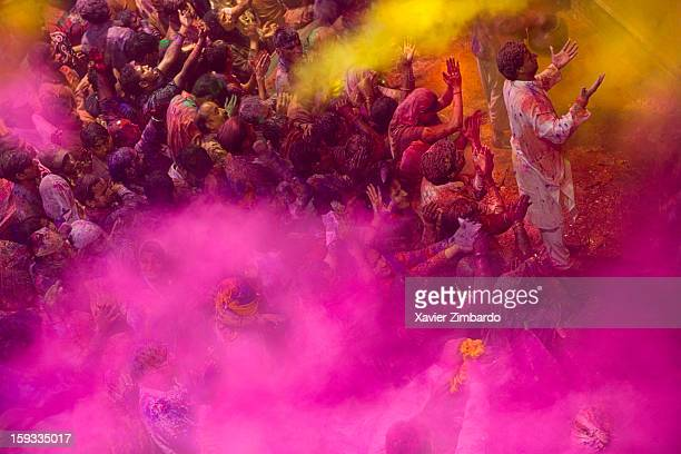 Thousands of pilgrims and devotees of Lord Krishna playing Holi at the Bankey Bihari Temple on February 27 2007 in Vrindavan India