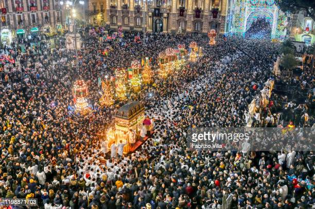 Thousands of pilgrims crowd Piazza Duomo to witness the beginning of the third day of celebrations in honour of the patron saint of Catania as...