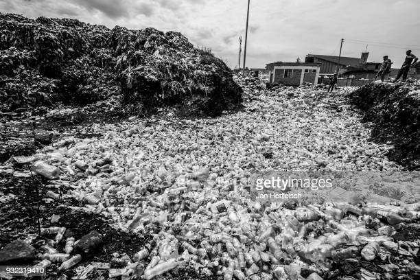 Thousands of plastic bottles lay on the ground at the Dandora rubbish dump on March 14 2018 in Nairobi Kenya The Dandora landfield is located 8...