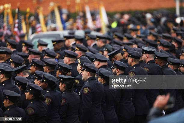 Thousands of police officers gather in the rain for the funeral service for New Jersey Detective Joseph Seals who died last week in a shooting that...
