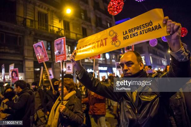 """Thousands of pro Catalonia's independence demonstrators with torches claiming amnesty for Catalan independence prisoners behind the slogan """"for..."""