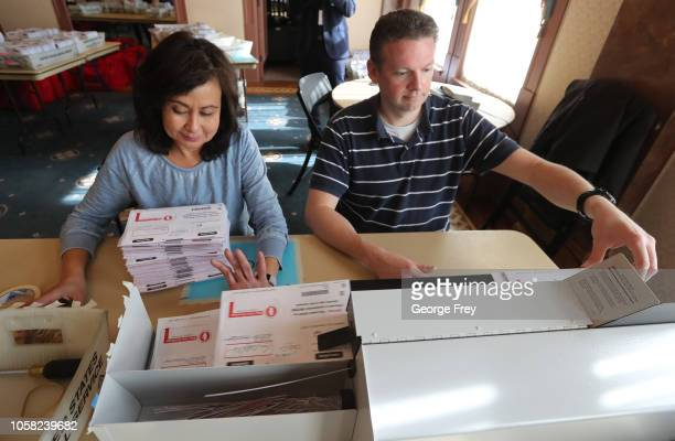 Thousands of processed mailin ballots are opened with a machine by Utah County election workers for the midterm elections on November 6 2018 in Provo...