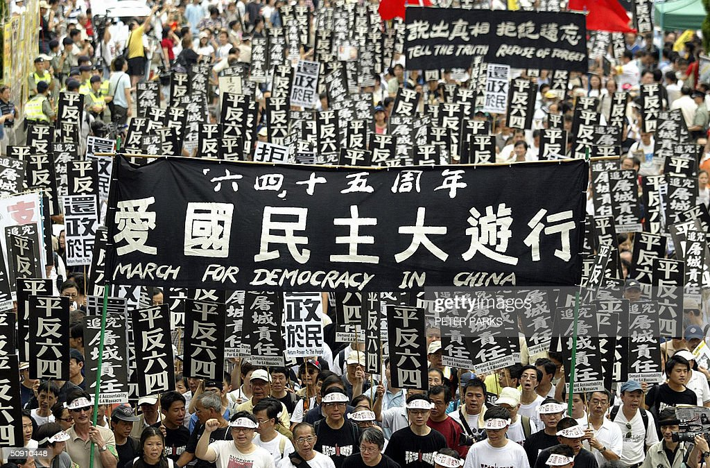 Thousands of pro-democracy supporters march in Hong Kong, 30 May 2004, to commemorate those killed in Tiananmen Square in Beijing in 1989. The march this year holds added significance for anxious Hong Kongers after a year that has seen China crush demands for democracy in the territory and mounting fears for media freedoms. AFP PHOTO/Peter PARKS