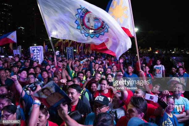 Thousands of proDuterte supporters cheer during a vigil rally in support of President Rodrigo Duterte's antidrug campaign which also coincided with...