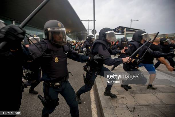 Thousands of proindependence activists of Catalonia try to occupy the Barcelona airport after publicizing the sentence against the independence...