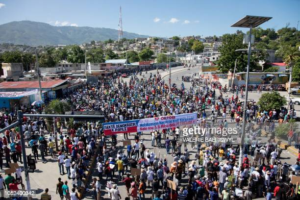 Thousands of protesters demonstrate in PortauPrince on October 17 calling for the resignation of President Jovenel Moise Civil society movements and...