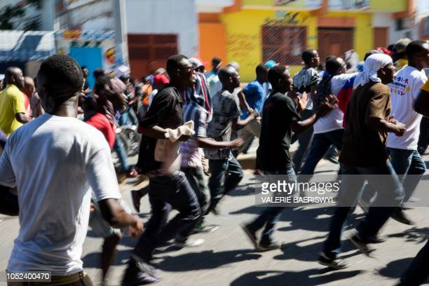 Thousands of protesters demonstrate in Port-au-Prince on October 17 calling for the resignation of President Jovenel Moise. - Civil society movements...