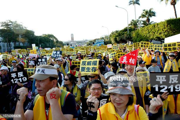 Thousands of protesters don yellow vests as they march for tax reforms in front of the presidential palace in Taipei on December 19 2018