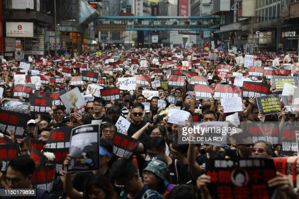 TOPSHOT Thousands of protesters dressed in black take part in a new rally against a controversial extradition law proposal in Hong Kong on June 16...