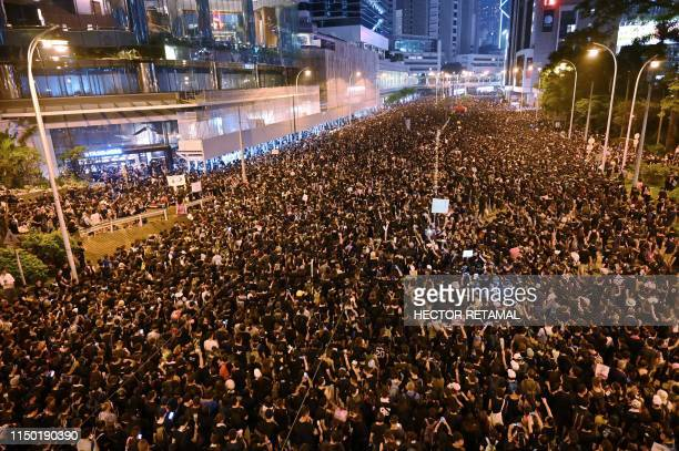 TOPSHOT Thousands of protesters dressed in black take part in a rally against a controversial extradition law proposal in Hong Kong on June 16 2019...