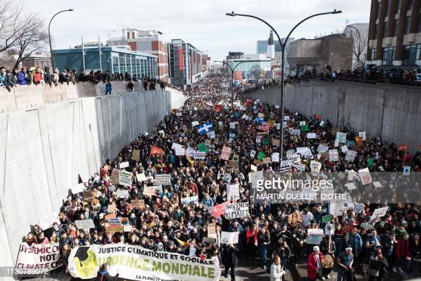 Thousands of protesters flood the streets of Montreal during the march for climate, on March 15 - Some 150,000 students throughout Quebec province...