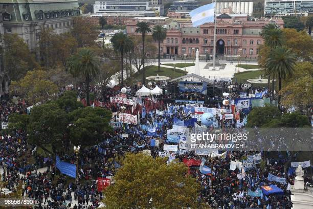 Thousands of protesters from the provinces and from the suburbs of the Argentine capital march towards the Plaza de Mayo in Buenos Aires on June 1 to...