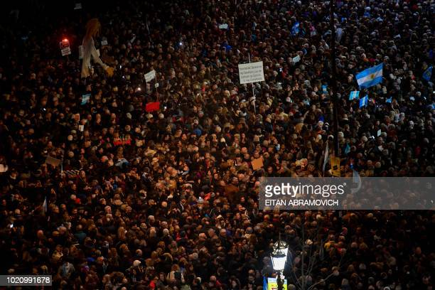 Thousands of protesters gather in front of the National Congress in Buenos Aires on August 21 2018 to demand senators to strip former Argentine...
