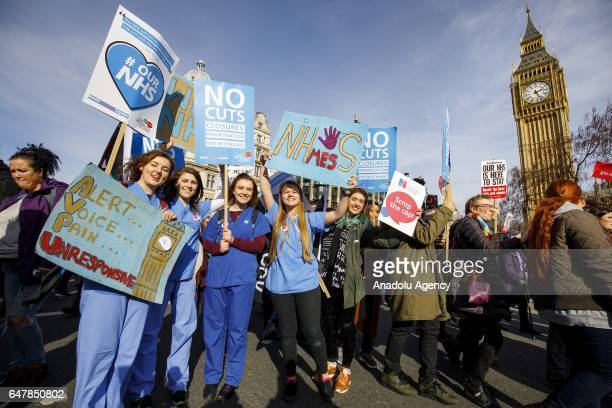 Thousands of protesters hold placards in Parliament Square during a demonstration in support of the National Health Service on March 4 2017 in London...