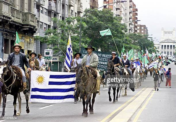 Thousands of protesters march 16 April in Montevideo during a demonstration called Because Another Uruguay is Possible The march was called for by...