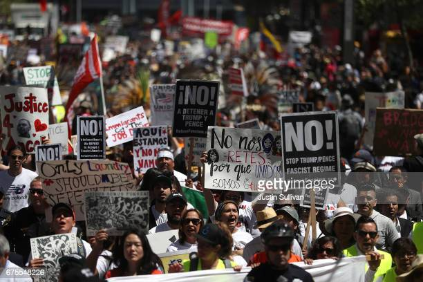 Thousands of protesters march down Market Street during a May Day demonstration on May 1 2017 in San Francisco California Thousands are expected to...