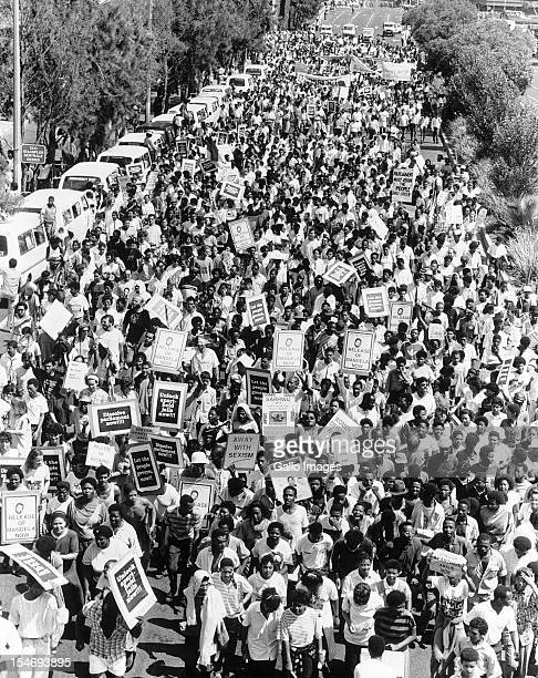 Thousands of protesters march for the release of anti-apartheid activist, Nelson Mandela, Johannesburg, South Africa, circa 1987.
