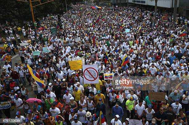 Thousands of protesters march in a massive antigovernment demonstration on March 2 2014 in Caracas Venezuela Venezuela has one of the highest...