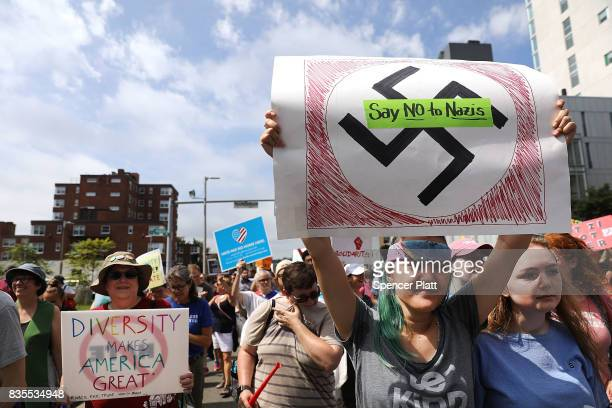Thousands of protesters march in Boston against a planned 'Free Speech Rally' just one week after the violent 'Unite the Right' rally in Virginia...