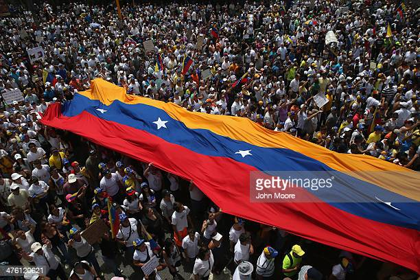 Thousands of protesters march in one of the largest antigovernment demonstrations yet on March 2 2014 in Caracas Venezuela Venezuela has one of the...