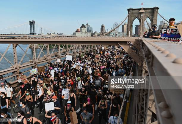 TOPSHOT Thousands of protesters march over the Brooklyn Bridge to demonstrate against the death of George Floyd on June 4 2020 in New York On May 25...