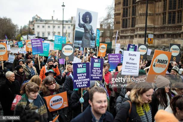 Thousands of protesters march with placards from the House of Parliament to Trafalgar Square during the March4Women event on March 4 2018 in London...