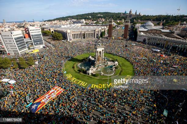 Thousands of protesters occupy the streets of Barcelona demanding the independence of Catalonia during the National Day of Catalonia, waving...