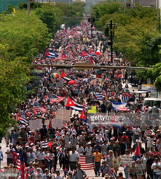 Thousands Of Protesters Pack A Street In Little Havana Carrying Flags And Signs During An Organized March April 29 2000 In Miami Many CubanAmericans...