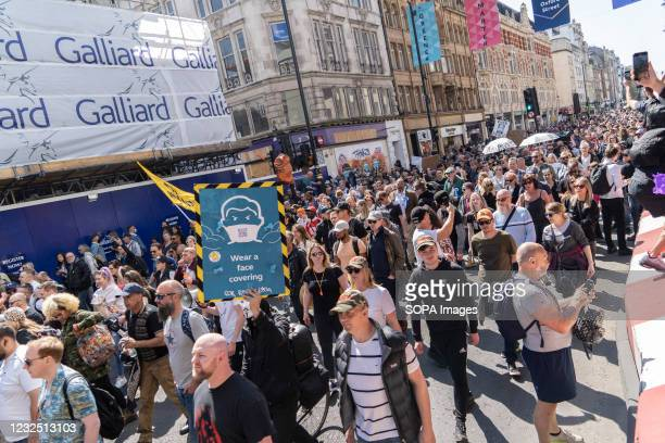 Thousands of protesters seen marching during the anti vaccine passport protest. Thousands of people protested in central London against the...