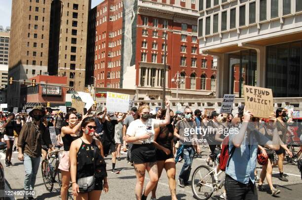 Thousands of protesters take to the street to demand the end to racist policing defund the Philadelphia Police Department and fund community needs...
