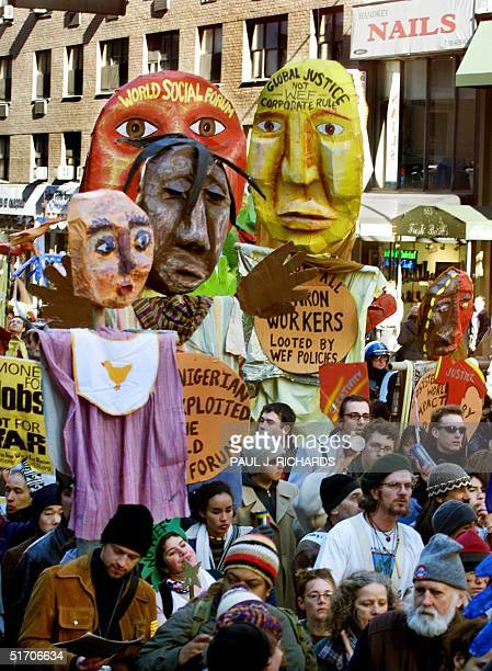 Thousands of protesters take to the streets of midtown Manhattan in New York 02 February 2002 as they come together to protest against the World...